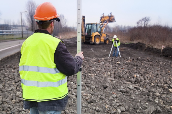 Yvnoep5ltkkkmmec1jya bigstock building a road  surveyors at 38645536